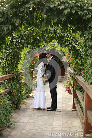 Bride and groom kissed in the green nature