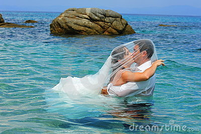 Bride and groom kissing - trash the dress