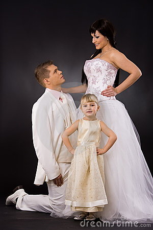 Bride, groom and little bridesmaid