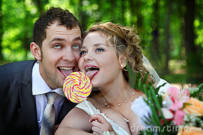Bride and groom with lollypop