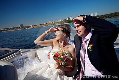 Bride and groom looking forward on the boat