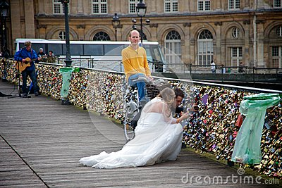 Bride and groom looking for their love padlock Editorial Stock Photo