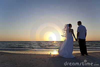 Bride & Groom Married Couple Sunset Beach Wedding Stock Photo