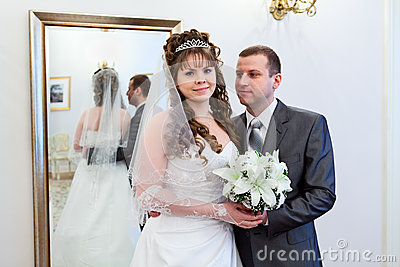 Bride and groom near mirror