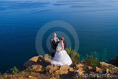 Bride and groom near the sea