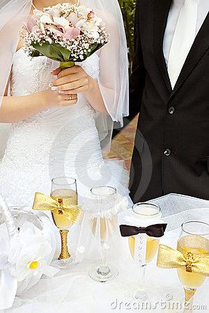 Bride and groom near wedding table