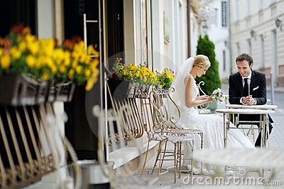 Bride and groom at outdoor cafe