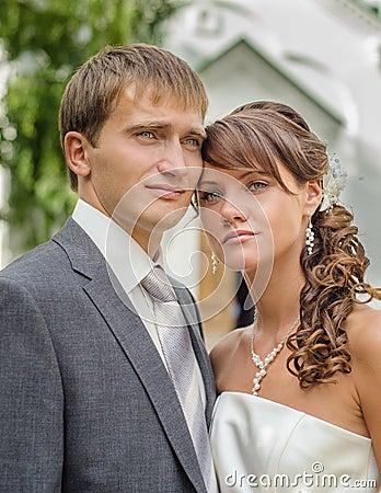 Bride and groom outdoor wedding portrait
