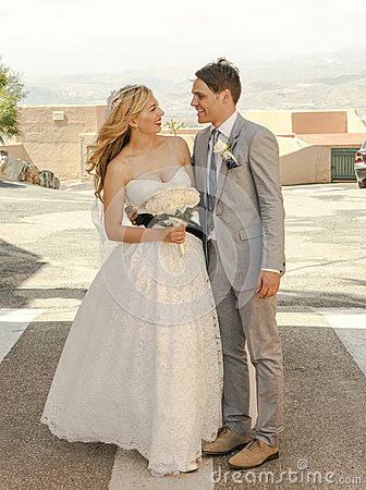 Bride and Groom outside in the sunshine