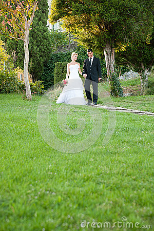 Bride and groom in a park outdoor