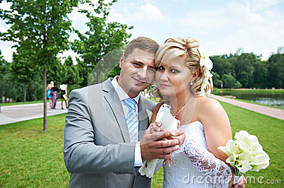 Bride and groom with pigeon on wedding walk