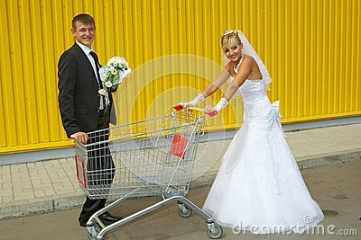 Bride and groom playing with a basket of supermarket