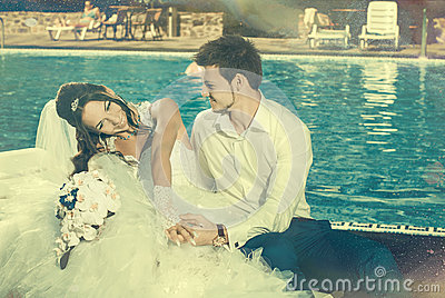 Bride and Groom at pool