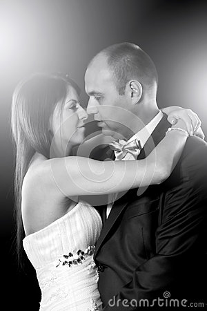 Bride and groom portrait over black