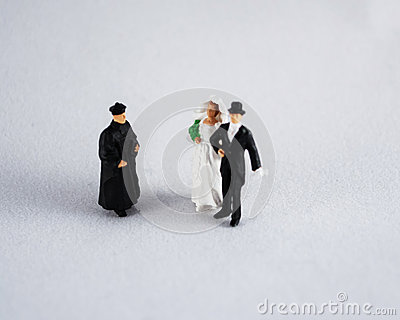 Bride, groom and priest on white