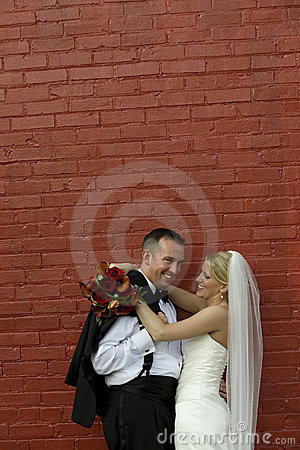 Bride and Groom at red brick wall