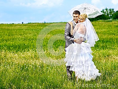 Bride and groom summer outdoor.