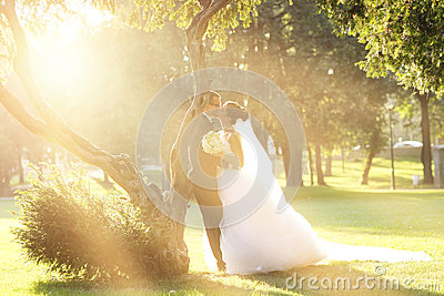 Bride and Groom surrounding by natural golden sunlight