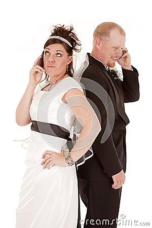 Bride groom talking on phone