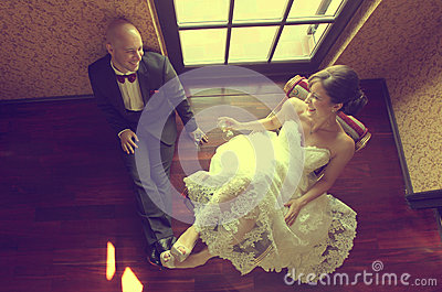 Bride and groom in their wedding day feeling great