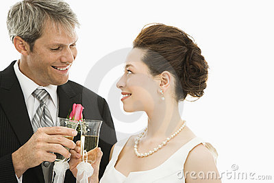 Bride and groom toasting.