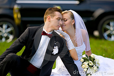 Bride and groom on wedding car background
