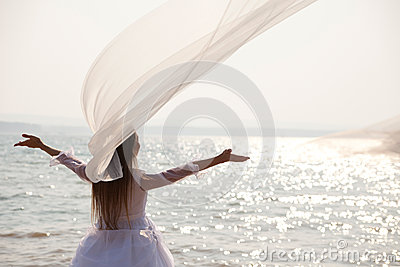 Bride with her arms raised