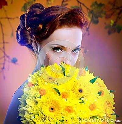 Bride hiding behind luxury bouquet