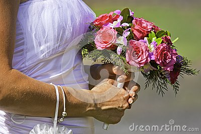 Bride holding beautiful bouquet of flowers