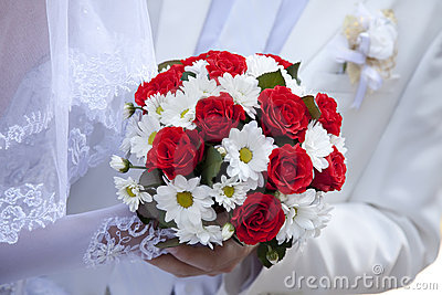 Bride holding beautiful red roses wedding  bouquet