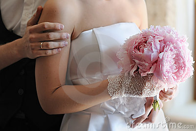 Bride holding beautiful wedding bouquet