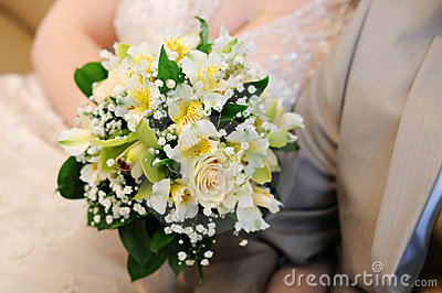 Bride holding beautiful yellow wedding bouquet