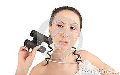 Bride holding binoculars