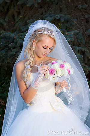 Bride holding a bouquet of hand