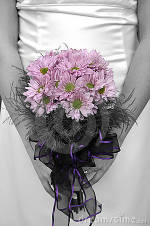 Bride holding bouquet with picture in black and white but flower