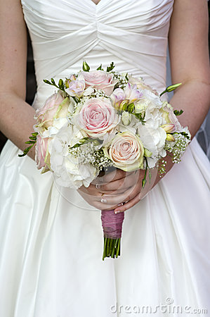 Bride holding a bouquet of wedding flowers