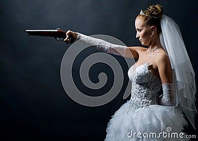 Bride holding old gun