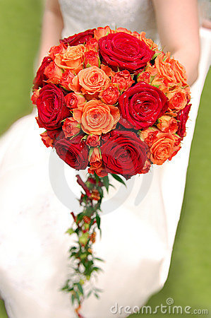 Bride holding orange bouquet