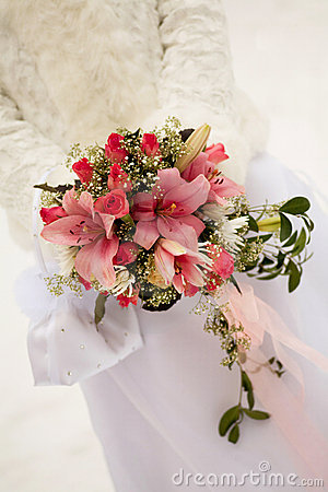 The bride holding pink wedding bouquet
