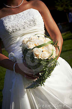 Bride Holding Rose Bouquet Stock Photo - Image: 19612300