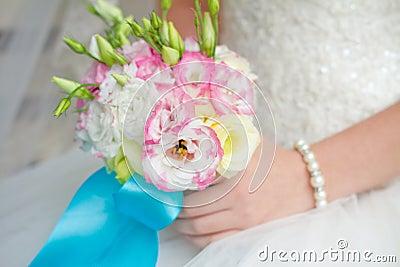 Bride holding wedding bouquet close up