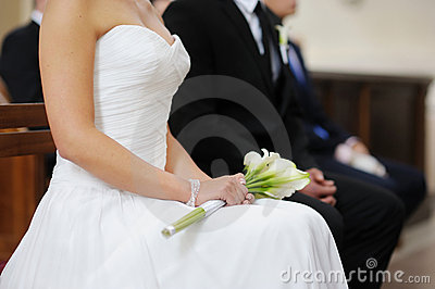 Bride holding white wedding flowers bouquet