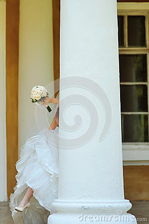 Bride holds a wedding bouquet