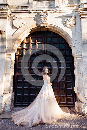Free Bride In Luxurious Dess Stands Before The Huge Steel Gates Royalty Free Stock Photos - 96023058