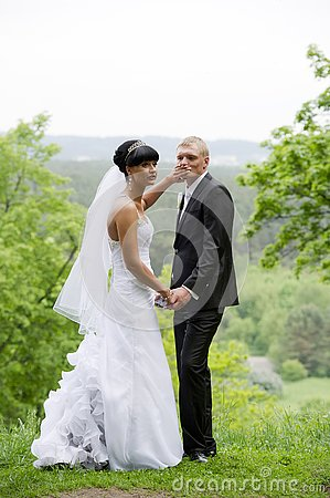 Free Bride Is Trying To Silence Groom. Royalty Free Stock Photos - 153715438