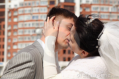 Bride kisses fiance outdoor