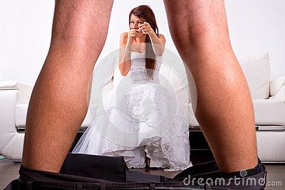 Bride laughing from the groom striptease