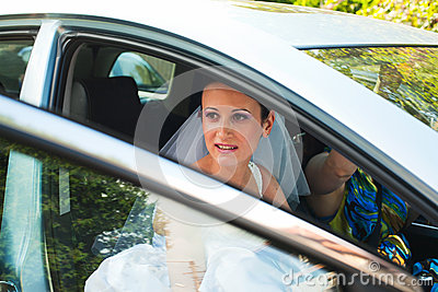 Bride leaving by car
