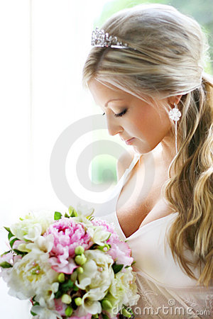 Bride Looking At Bouquet Stock Photo - Image: 3489530