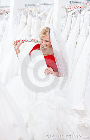 Bride is looking forward to try dress on